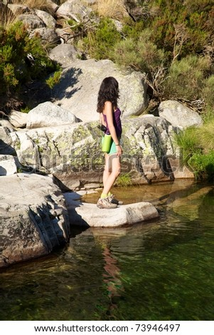 woman on a river at Gredos mountains in Avila Spain