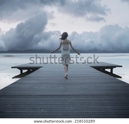 Woman on a wooden bridge - stock photo