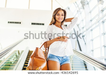woman on an escalator