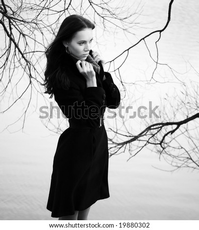 Woman on autumn branch background. Concept black and white image. - stock photo