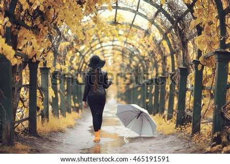 woman on autumn walk in the city
