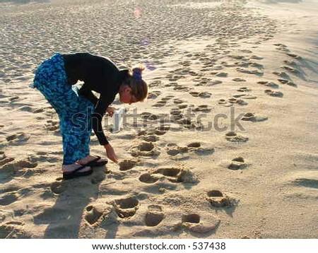 woman on beach - stock photo