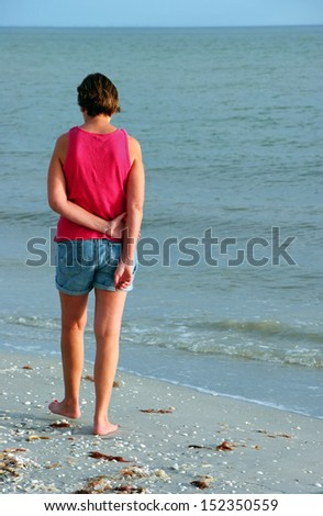 Woman On Beach at Dusk Sanibel Island Florida - stock photo