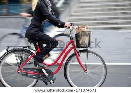 Woman on bike in profile - stock photo