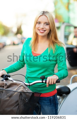 Woman on bike with shopping bags - stock photo