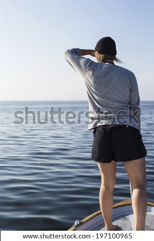 Woman on boat, Sweden - stock photo