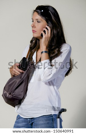 woman on business with mobile and bag over shoulder