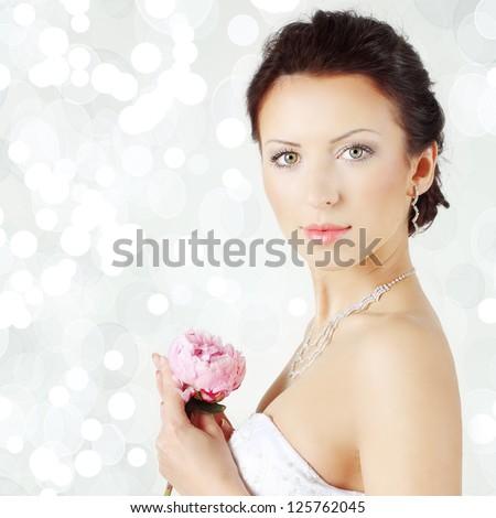 Woman on celebration background, beautiful bride - stock photo