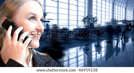 woman on cellphone at the airport - stock photo