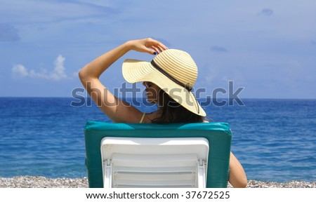 woman on chaise longue
