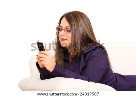Woman on couch with mobile phone