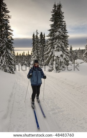 Woman on cross-country skis - stock photo