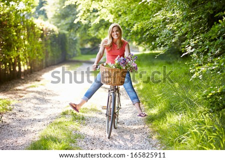 Woman On Cycle Ride In Countryside - stock photo