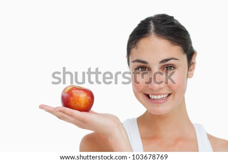 Woman on diet with an apple in the hand against white background