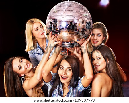 Woman on disco in night club. Disco ball. - stock photo
