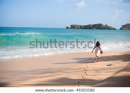 Woman on exotic beach - stock photo