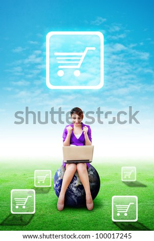 Woman on globe present the Cart icon on the blue sky and grass field : Elements of this image furnished by NASA - stock photo
