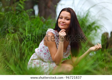 woman on grass in green fields