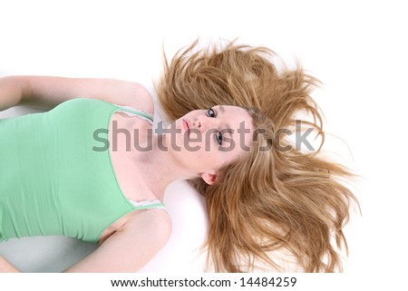woman on her back with her hair spread out like she fell from up high - stock photo