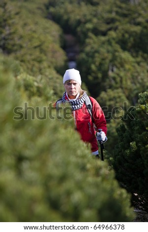 Woman on hiking trail, Nordic Walking in Autumn mountains - stock photo