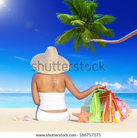 Woman on Holiday by the Beach with Shopping Bags - stock photo