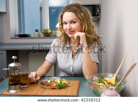 woman on kitchen with food