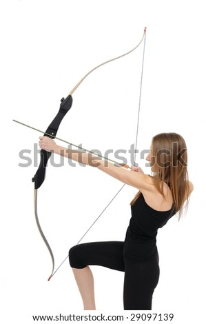 Woman on knee aiming with bow - studio shot