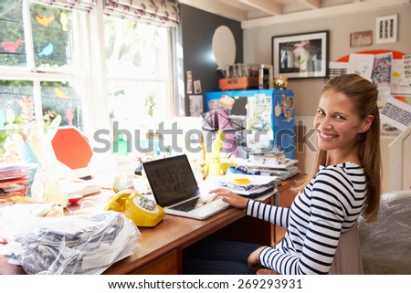 Woman On Laptop Running Business From Home Office - stock photo