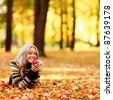 woman on leafs in autumn park - stock photo