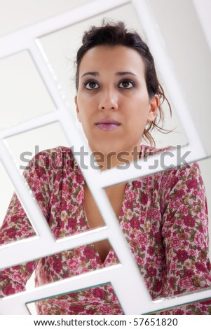 woman on mirror, broken. Studio shot - stock photo