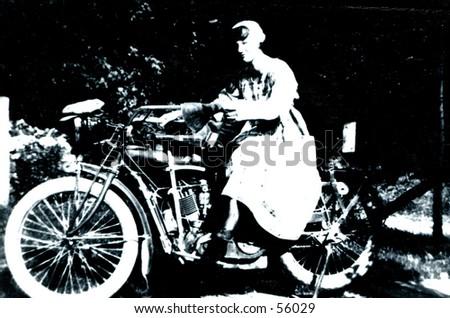 Woman on Motorcycle 1917 - stock photo