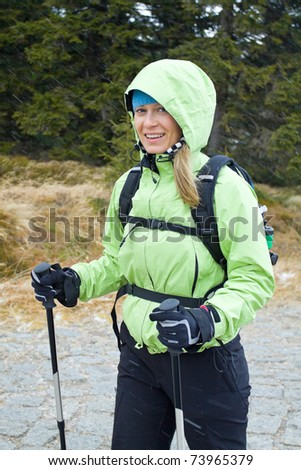 Woman on nordic walking trip in winter mountains - stock photo
