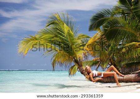 woman on palm sea on backgroud - stock photo