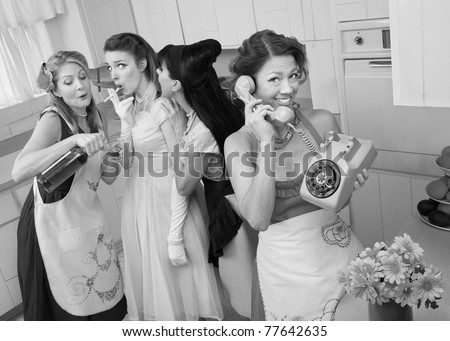 Woman on phone while friends give young woman cigarette and alcohol in a retro styled kitchen scene - stock photo