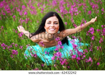 woman on pink flower field