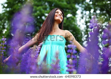 woman on pink flower field - stock photo