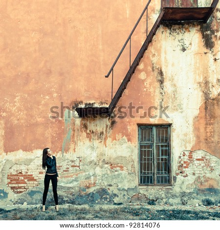 woman on ruins look at stairway - stock photo