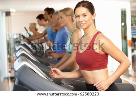 Woman On Running Machine In Gym - stock photo