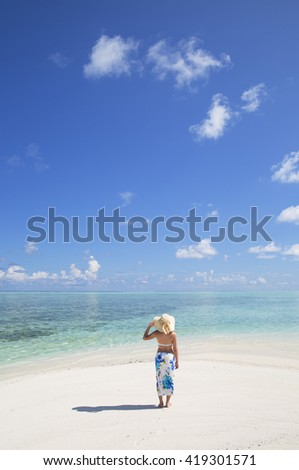 Woman on sandbank, South Male Atoll, Kaafu Atoll, Maldives