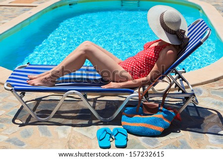 woman on sea vacation by the pool - stock photo