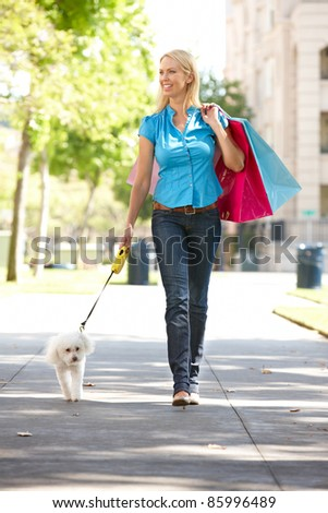 Woman on shopping trip with dog - stock photo