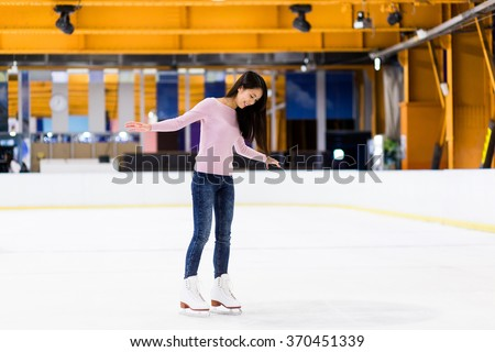 Woman on skating rink - stock photo