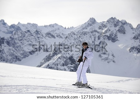 woman on skis in the mountains - stock photo