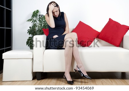 Woman on sofa expressing concern