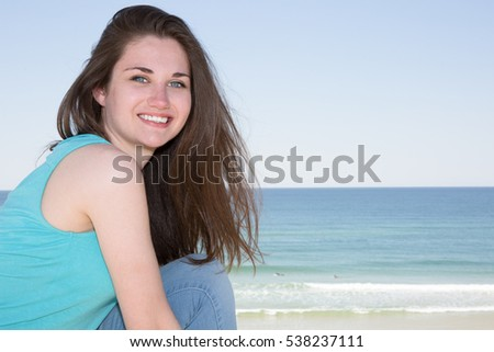 Woman on sunny day in summer at beach during holidays