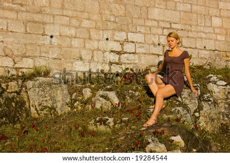 Woman on the ancient stones - stock photo