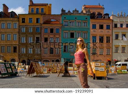 Woman on the ancient street in warsaw - stock photo