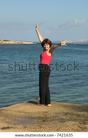 woman on the beach - stock photo