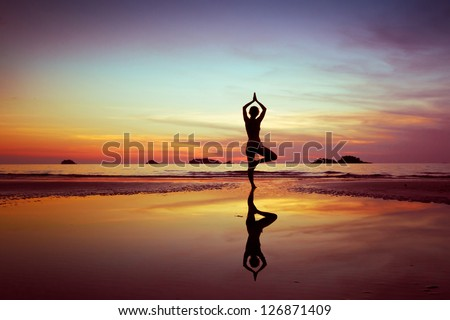 woman on the beach at sunset - stock photo