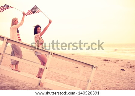 Woman on the Beach at sunset  with USA flags American youth concepts - stock photo